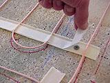 Монтаж теплого пола : закрепляем кабель